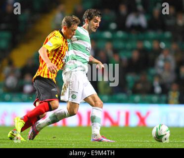 Glasgow, Scotland. 29th Oct, 2014. Scottish League Cup. Celtic versus Partick Thistle. Charlie Mulgrew battles with - Stock Photo
