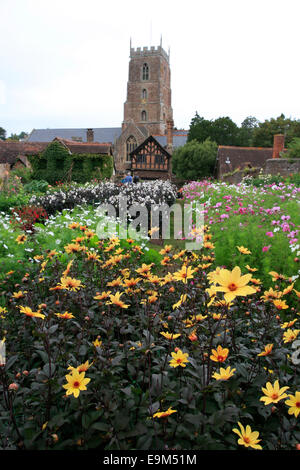 The Dream Garden in Dunster and St George 's Church behind - Stock Photo