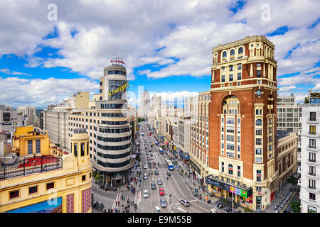 MADRID, SPAIN - OCTOBER 15, 2014: Gran Via at the Iconic Schweppes Building. The street is the main shopping district - Stock Photo