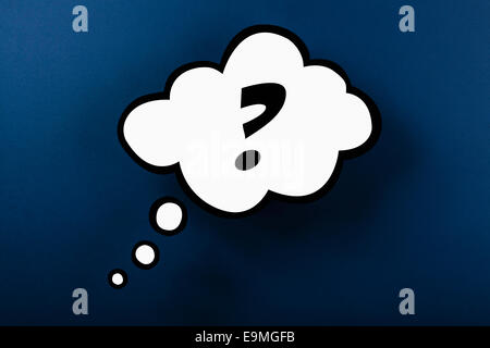 Question mark thought bubble against blue background - Stock Photo