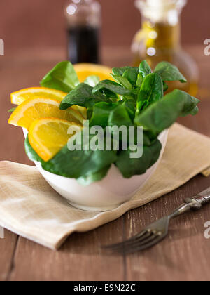 Lamb's lettuce with oranges - Stock Photo