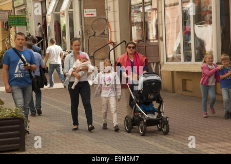 Mothers with children stroll in the old town center in Zielona Gora, poland. - Stock Photo