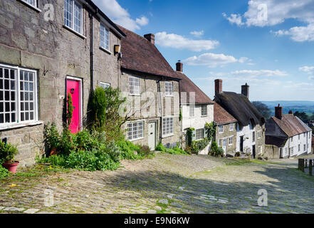 Picturesque English cottages on a cobbled street at Gold Hill in Shaftestbury in Dorset - Stock Photo