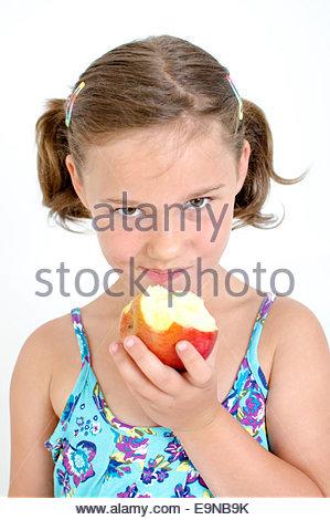 Girl eats an Apple - Stock Photo