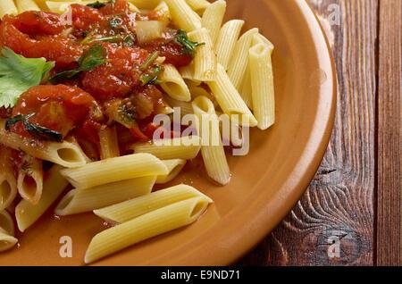 penne rigata with marinara sauce - Stock Photo