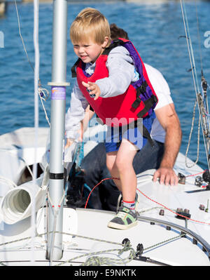 Freddie Simpson 4, and Iain Percy aboard their Star class keel-boat for the Bart's Bash sailing regatta in Weymouth, - Stock Photo
