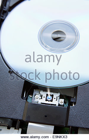 Blue ray disk installed in device - Stock Photo