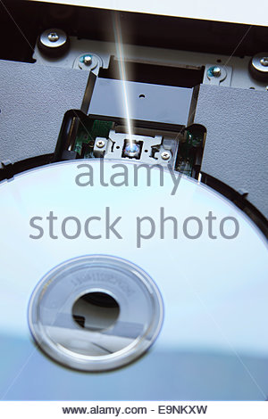 Blue ray disk inside device - Stock Photo