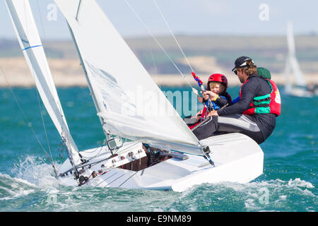 Freddie Simpson 4, and Iain Percy aboard their Star class keel-boat for the Bart's Bash sailing regatta - Stock Photo