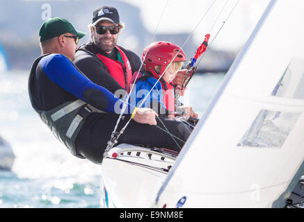 Freddie Simpson 4, and Iain Percy aboard their Star class keel-boat along with Australian sailor Anthony Nossiter - Stock Photo