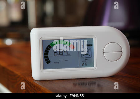 Close-up of a domestic electricity monitor showing a high level of energy consumption - 8.84Kw - Stock Photo