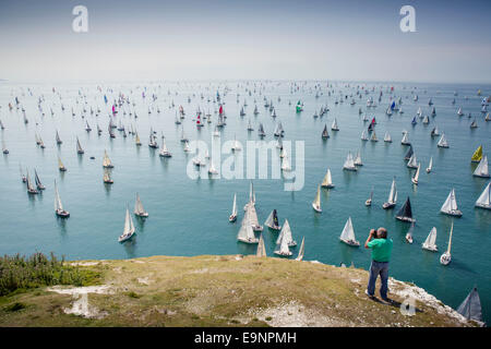 Yachts pass the Needles heading for St Catherine's Point during the 2014 JP Morgan Asset Management Round the Island - Stock Photo