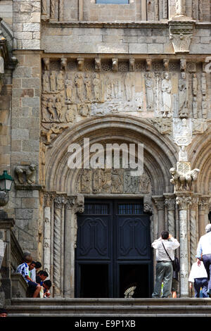 Tourists and Porta das Prateirias on south facade of cathedral , Santiago de Compostela , Galicia , Spain - Stock Photo