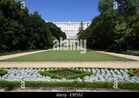 Flowers in Campo de Moro gardens, Royal Palace behind, Madrid, Spain - Stock Photo