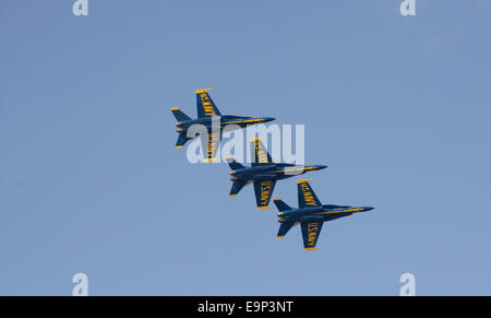 Three US Navy Blue Angels aircraft in flight against a blue sky - Stock Photo