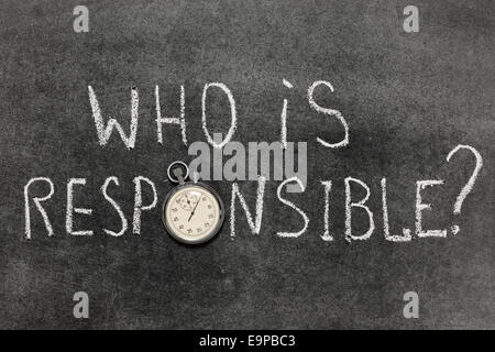 who is responsible question handwritten on chalkboard with vintage precise stopwatch used instead of O - Stock Photo