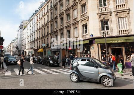 Smart car in Le Marais - trendy district of Paris - Stock Photo