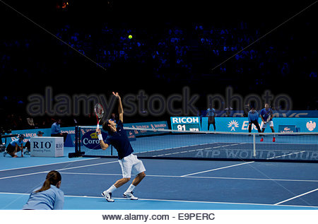 Swiss tennis player, Roger Federer serving against Jo-Wilfred Tsonga of France at the 2011 ATP World Tour Finals - Stock Photo