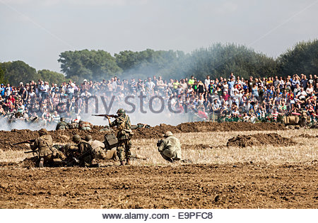 Living History Re-enactors re-enacting a world war two battle at The Victory Show in Leicestershire - 2014 - Stock Photo