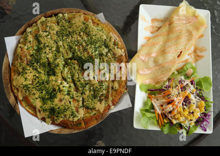 Pizza Japanese style with Crepe Cake in a cafe - Stock Photo