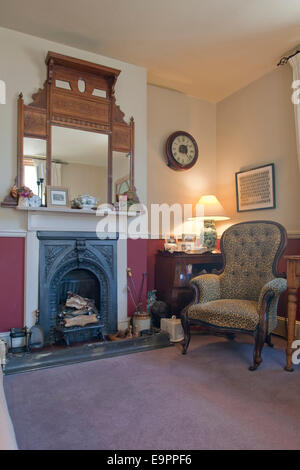 Victorian fireplace and mirrored overmantel in Victorian home, Kingston upon Thames, England, UK - Stock Photo
