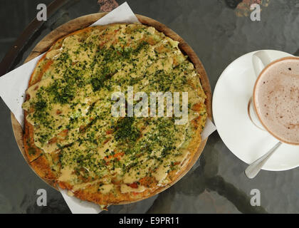 Pizza Japanese style in a cafe - Stock Photo