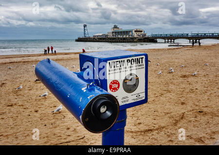 View Point telescope with Bournemouth pier, beach and people in the background. Dorset, England, UK. - Stock Photo