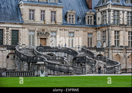 Horseshoe stairway of the Palace of Fontainebleau / Château royal de Fontainebleau near Paris, Île-de-France, France - Stock Photo