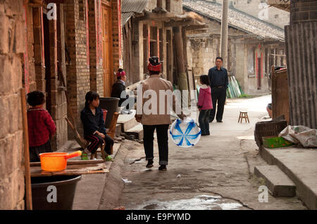 Street scene in a Miao village close to Shidong, China - Stock Photo