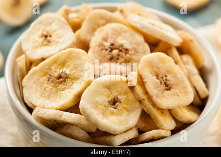 Homemade Dehydrated Banana Chips in a Bowl - Stock Photo