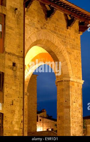 San Gimignano, Tuscany, Italy. Illuminated loggia of the Palazzo Comunale, Piazza del Duomo. - Stock Photo