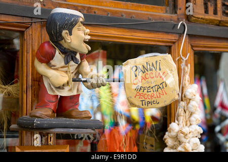 Siena, Tuscany, Italy. Amusing sign outside corner shop in Via Tito Sarrocchi selling traditional food products. - Stock Photo