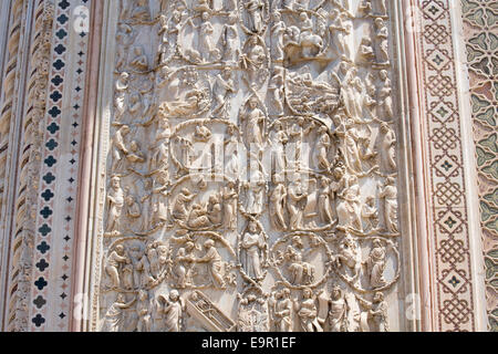 Orvieto, Umbria, Italy. Bas-relief depicting the Tree of Jesse and scenes from the Old Testament on façade of the - Stock Photo