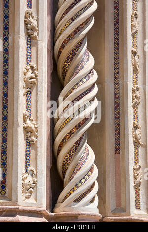 Orvieto, Umbria, Italy. Richly decorated spiral column on façade of the cathedral. - Stock Photo