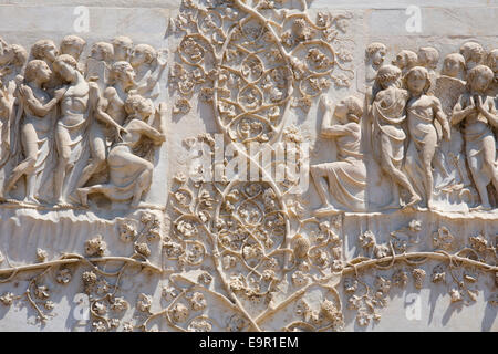 Orvieto, Umbria, Italy. Intricately carved bas-relief depicting the Last Judgment on façade of the cathedral. - Stock Photo