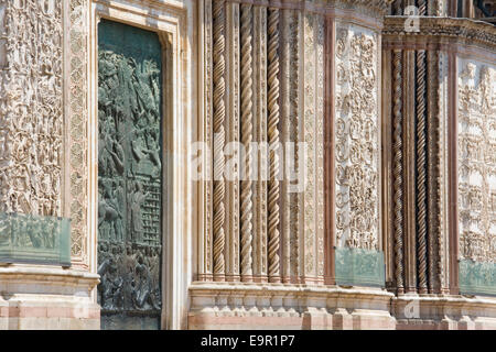 Orvieto, Umbria, Italy. Richly decorated west front of the cathedral. - Stock Photo
