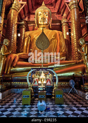 The 14th Century Buddha statue at Wat Phanan Choeng temple in Ayutthaya, Thailand. - Stock Photo