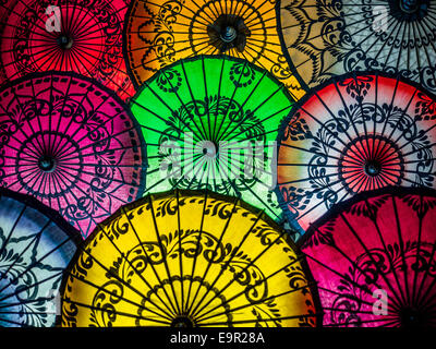 Colorful umbrellas on display at street market in Bagan, Mandalay Region, Myanmar (Burma). - Stock Photo