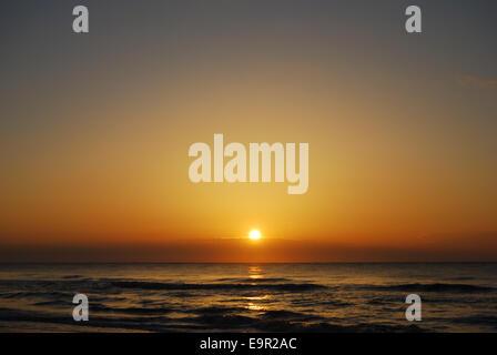 A intensely beautiful Atlantic Ocean sunrise on Hunting Island in South Carolina, USA. - Stock Photo