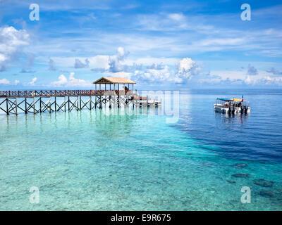 Boats at dive site off of the coast of world famous Pulau Sipadan island in Sabah, East Malaysia. - Stock Photo