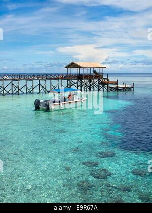 Boat next to pier at world famous Pulau Sipadan island in Sabah, East Malaysia. - Stock Photo