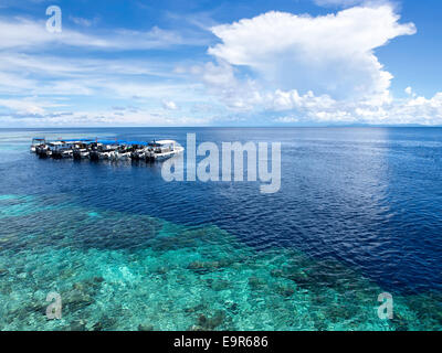 Boats at dive site off of the coast of world famous Sipadan Island in Sabah, East Malaysia. - Stock Photo