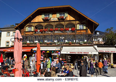 People gather in front of Hotel Schiffmeister, staging area for Königssee excursion boats going to the Church of - Stock Photo