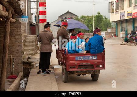 Miao women on a three-wheeler, Shidong, Guizhou Province, China - Stock Photo