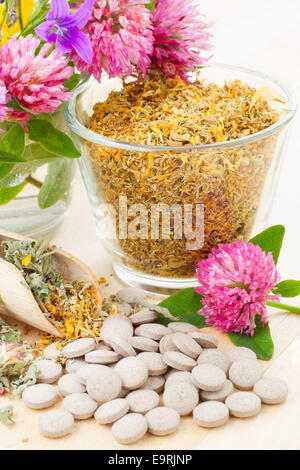 healing herb in glass, tablets, herbal medicine - Stock Photo