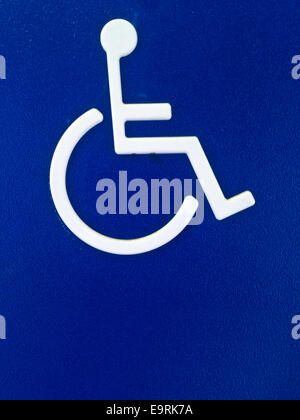 Disability person symbol on blue metal sheet - Stock Photo