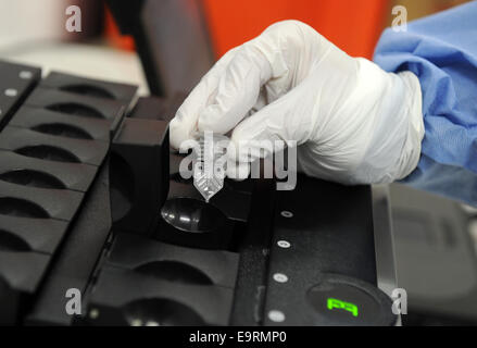 Munich, Germany. 31st Oct, 2014. A soldier puts a sample in a PCR device for DNA analysis in the training area of - Stock Photo