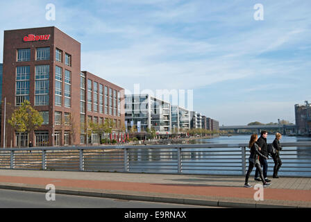 pedestrians crossing a bridge over the inner harbour, or innenhafen, duisburg, germany, - Stock Photo