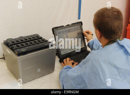 Munich, Germany. 31st Oct, 2014. A soldier tests a sample in a PCR device for DNA analysis in the training area - Stock Photo