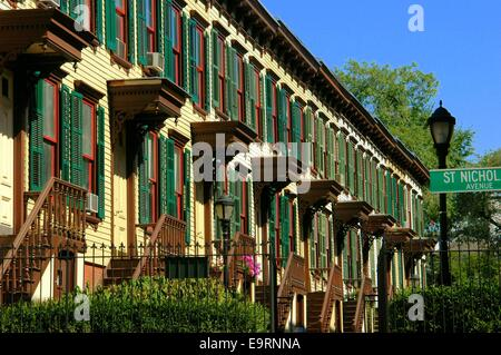 NYC: A row of unique wooden houses on Sylvan Terrace in the Jumel Historic District of Upper Harlem - Stock Photo